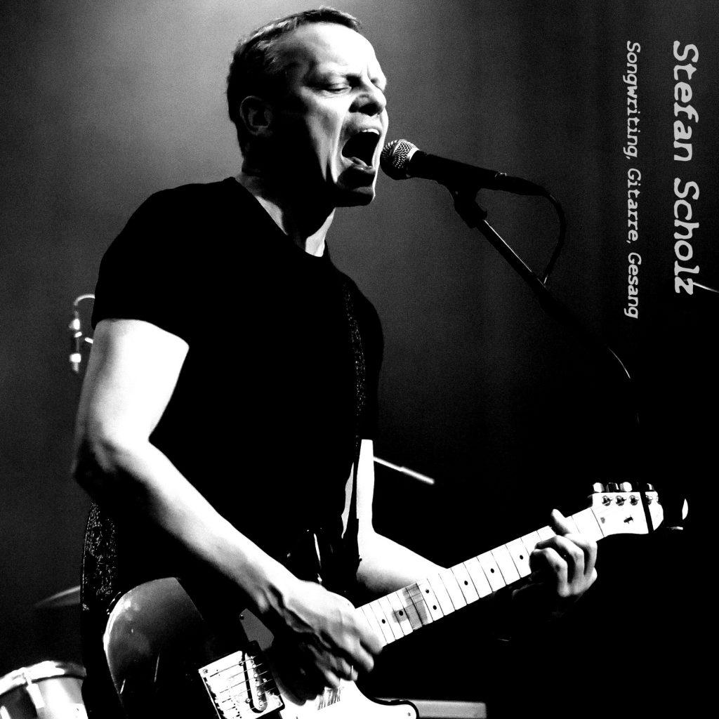 Stefan Scholz (Songwriting, Gitarre ,Gesang)